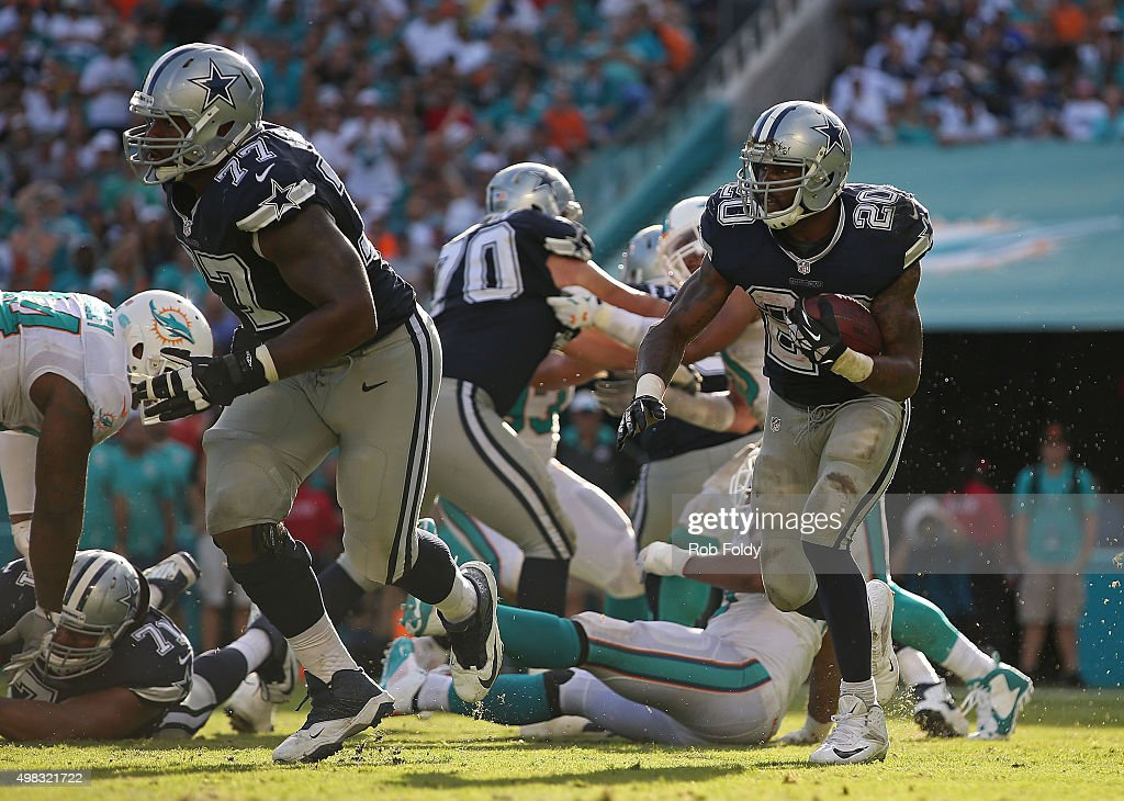 Darren McFadden #20 of the Dallas Cowboys runs as Tyron Smith #77 blocks during the second half of the game against the Miami Dolphins at Sun Life Stadium on November 22, 2015 in Miami Gardens, Florida.