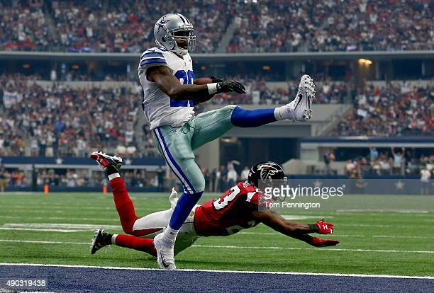 Darren McFadden of the Dallas Cowboys scores a touchdown as Robert Alford of the Atlanta Falcons defends in the second quarter at ATT Stadium on...