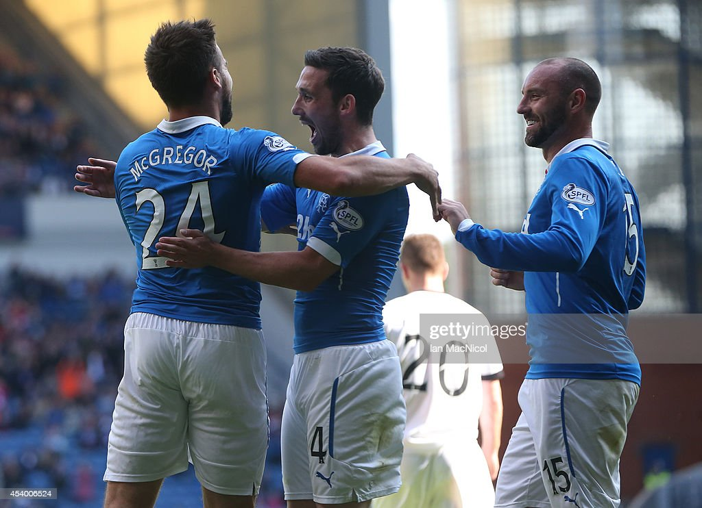 Darren McGregor (L) celebrates with team mates Nicky Clark and Kris Boyd after he scores during the Scottish Championship League Match between Rangers and Dumbarton, at Ibrox Stadium on August 23, 2014 Glasgow, Scotland.