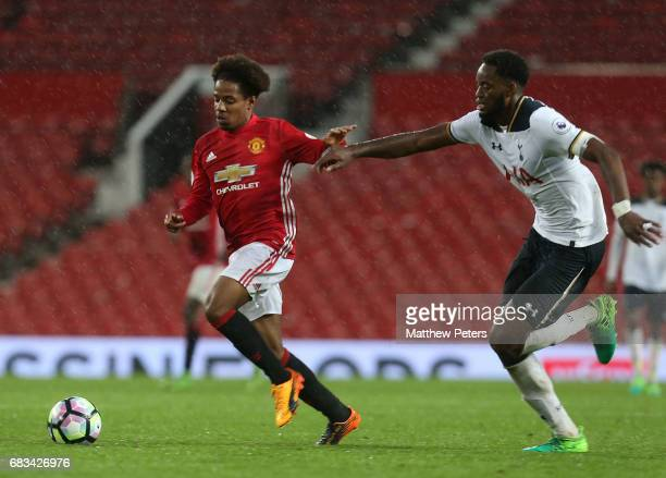 Darren McIntoshBuffonge of Manchester United U23s in action with Christian Maghoma of Tottenham Hotspur U23s during the Premier League 2 match...
