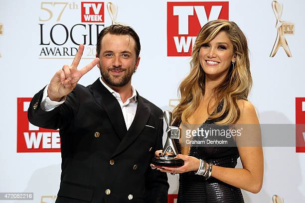 Darren McMullen and Delta Goodrem pose in the awards room after winning a Logie for Most Outstanding Light Entertainment Program at the 57th Annual...