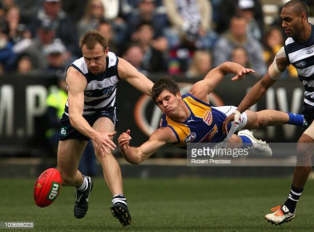 Darren Milburn of the Cats and Koby Stevens of the Eagles contest the ball during the round 22 AFL match between the Geelong Cats and the West Coast...