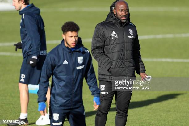 Darren Moore First Team Coach of West Bromwich Albion and Tyler Roberts during a West Bromwich Albion Training Session on January 22 2018 in West...