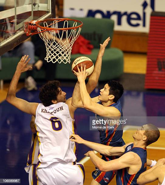 Darren Ng of the 36ers gets two points during the round four NBL match between the Adelaide 36ers and the Sydney Kings at Distinctive Homes Dome on...