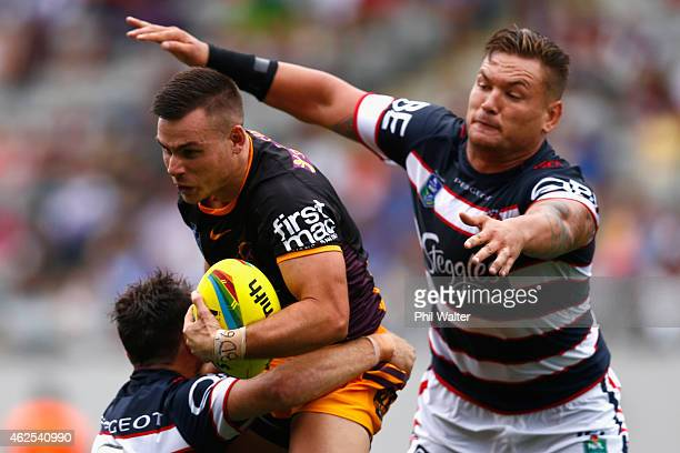 Darren Nicholls of the Broncos is tackled during the match between the Broncos and the Roosters in the 2015 Auckland Nines at Eden Park on January 31...
