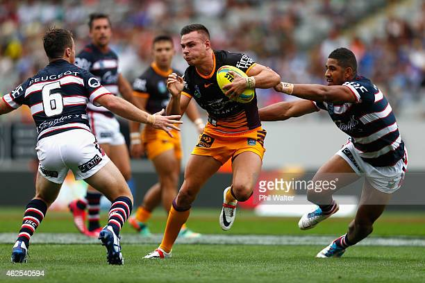 Darren Nicholls of the Broncos runs in a try during the match between the Broncos and the Roosters in the 2015 Auckland Nines at Eden Park on January...