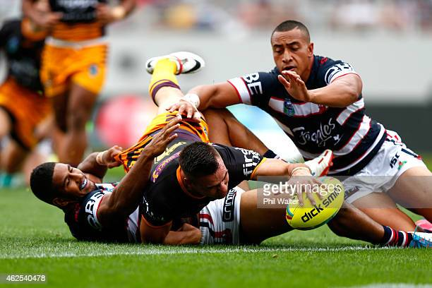 Darren Nicholls of the Broncos scores a try during the match between the Broncos and the Roosters in the 2015 Auckland Nines at Eden Park on January...