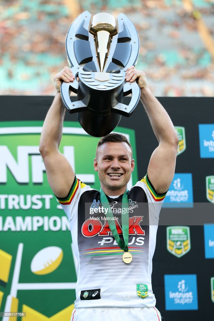Darren Nicholls of the Panthers holds aloft the trophy after winning the 2017 State Championship Final between the Penrith Panthers and Papua New Guinea Hunters at ANZ Stadium on October 1, 2017 in Sydney, Australia.