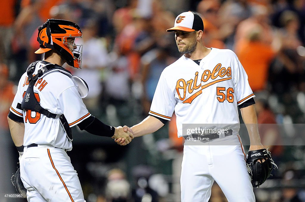 Darren O'Day #56 of the Baltimore Orioles celebrates with Caleb Joseph #36 after a 9-4 victory against the Seattle Mariners at Oriole Park at Camden Yards on May 19, 2015 in Baltimore, Maryland.
