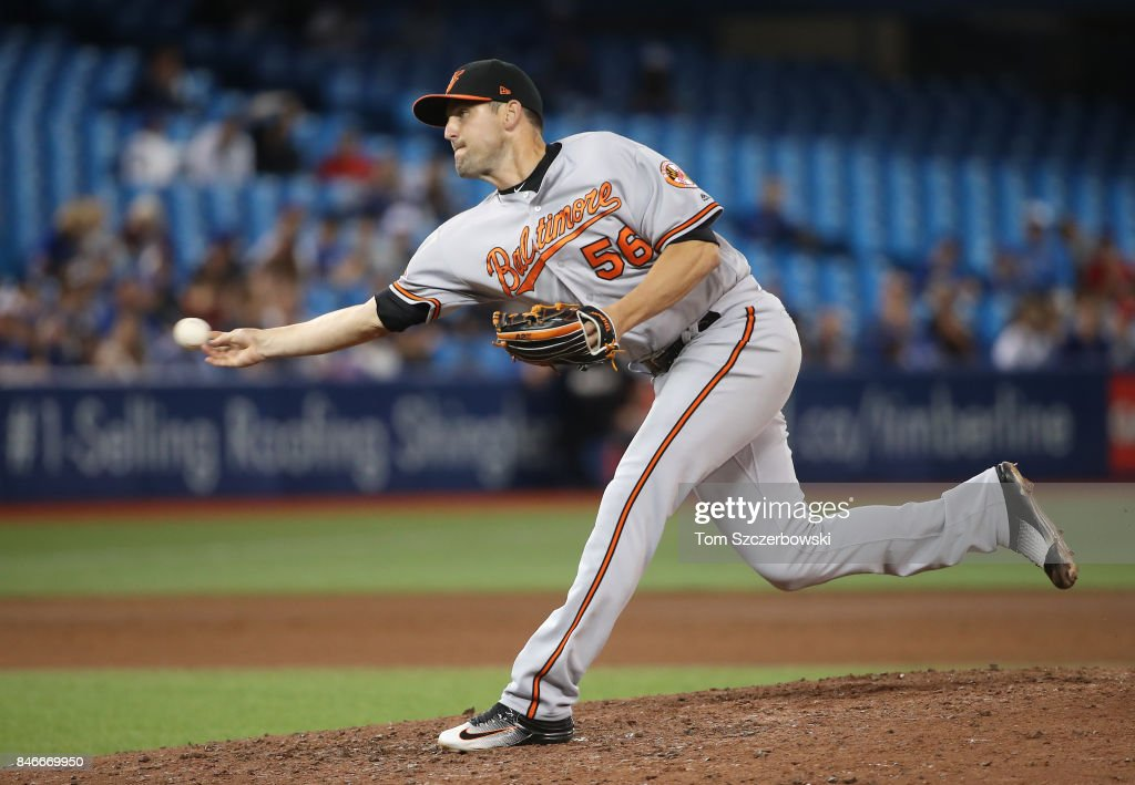 Darren O'Day #56 of the Baltimore Orioles delivers a pitch in the eighth inning during MLB game action against the Toronto Blue Jays at Rogers Centre on September 13, 2017 in Toronto, Canada.