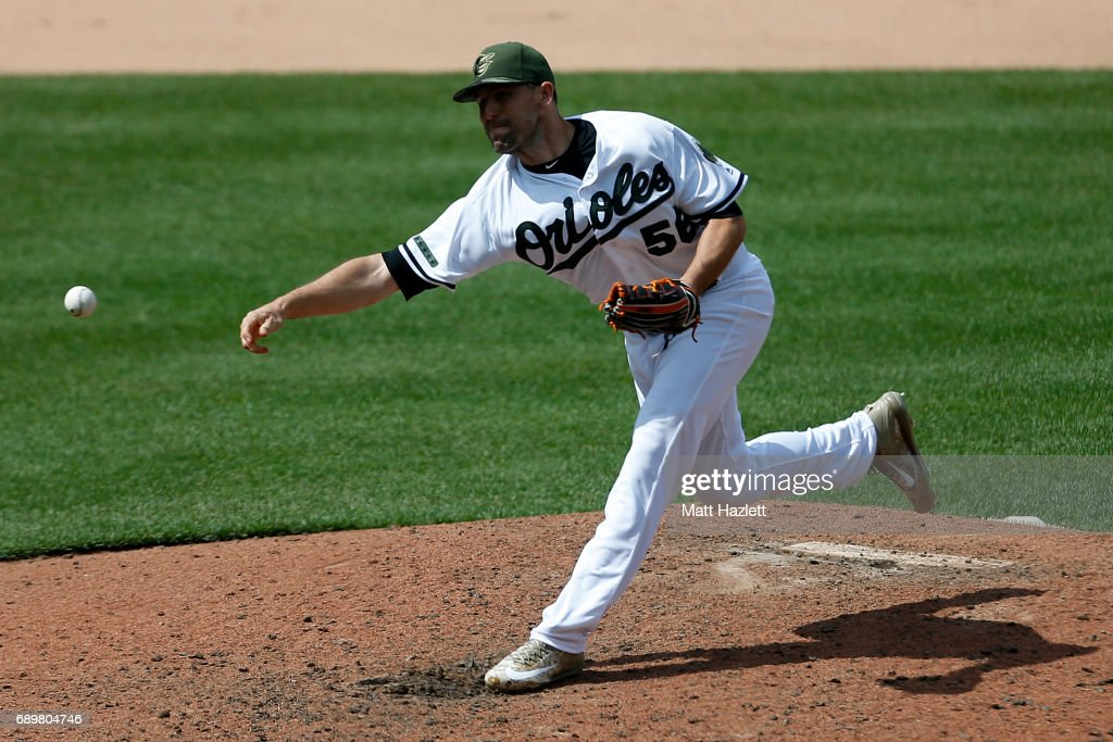 Darren O'Day #56 of the Baltimore Orioles pitches against the New York Yankees during the eighth inning at Oriole Park at Camden Yards on May 29, 2017 in Baltimore, Maryland. MLB players across the league are wearing special uniforms to commemorate Memorial Day.