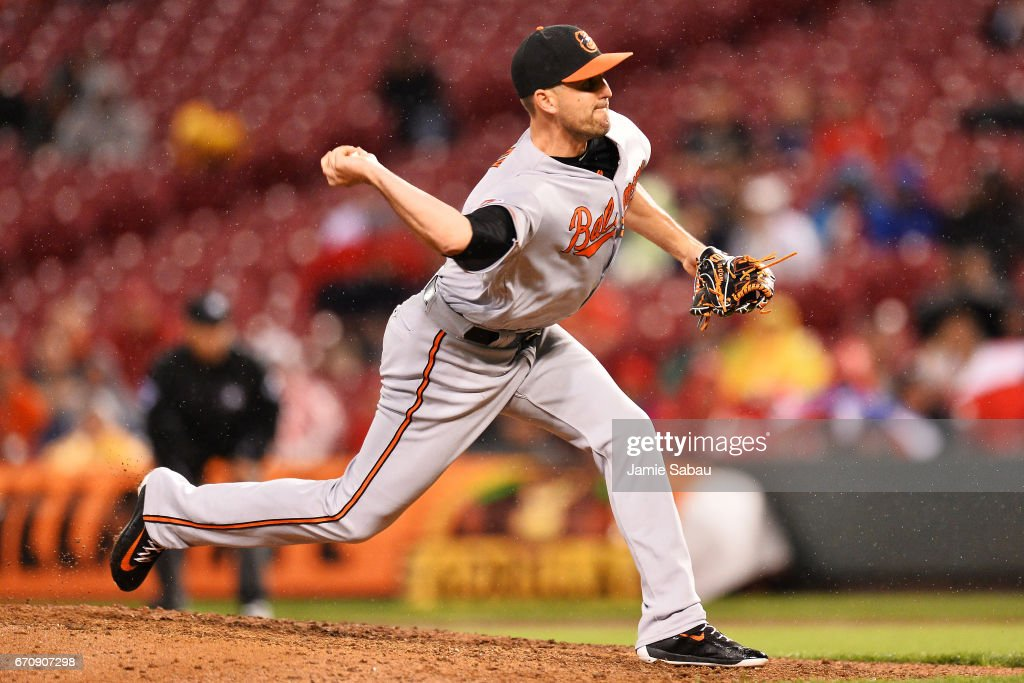 Darren O'Day #56 of the Baltimore Orioles pitches in the ninth inning against the Cincinnati Reds at Great American Ball Park on April 20, 2017 in Cincinnati, Ohio. Baltimore defeated Cincinnati 2-1 in 10 innings.