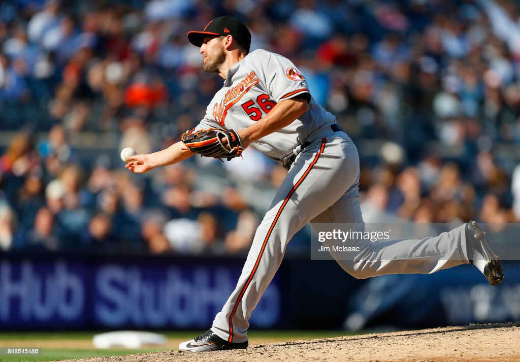 Darren O'Day #56 of the Baltimore Orioles pitches in the seventh inning against the New York Yankees at Yankee Stadium on September 17, 2017 in the Bronx borough of New York City.