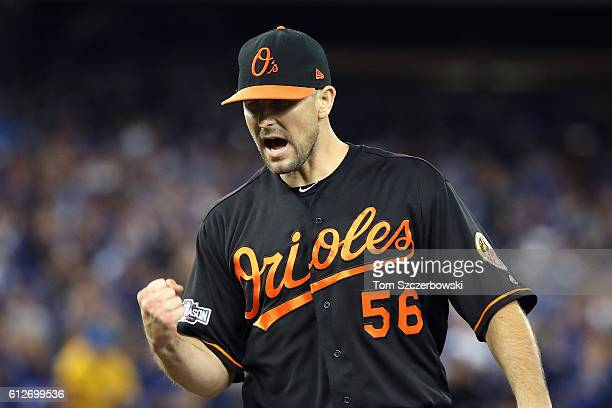 Darren O'Day of the Baltimore Orioles reacts after a double play in the ninth inning during the American League Wild Card game against the Toronto...