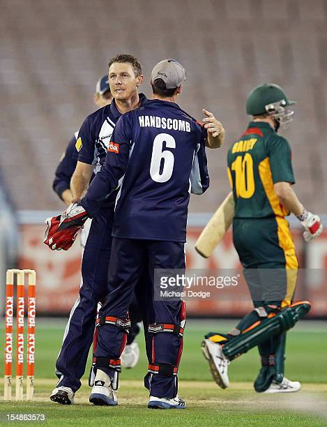 Darren Pattison of the Bushrangers celebrates with wicketkeeper Peter Hanscomb after dismissing George Bailey of the Tigers during the Ryobi One Day...