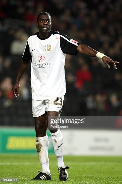 Darren Powell of MK Dons in action during the Johnstone's Paint Trophy Southern Area Quarter Final Match between MK Dons and Northampton Town at...