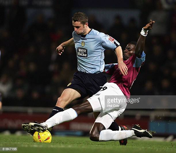 Darren Powell of West Ham tacles Frazer Richardson of Leeds United during the Coca Cola Championship match between West Ham United and Leeds Unitedl...
