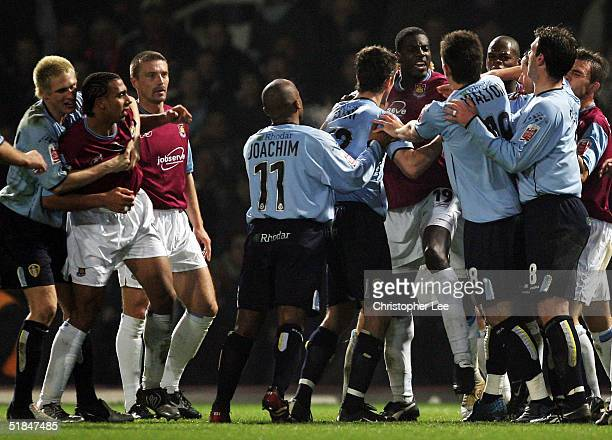 Darren Powell of West Ham United argues with Simon Walton of Leeds United after the penalty decision during the Coca-Cola Championship match between...