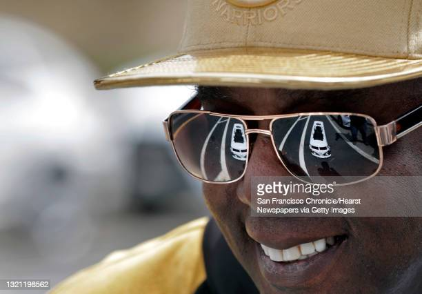 Darren Powell with his FreeïDoubleïYou Bus motorized skateboard reflected in his sunglasses along Lake Merritt in Oakland, Calif., on Thursday,...