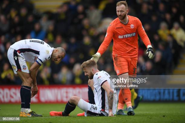 Darren Pratley and Ben Alnwick check if team mate Mark Beevers of Bolton Wanderers is ok during the Sky Bet Championship match between Burton Albion...