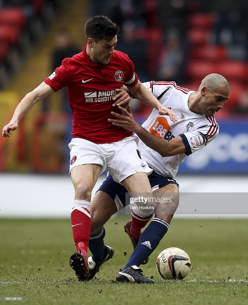 Darren Pratley of Bolton holds off the challenge of Johnnie Jackson (L) of Charlton during the npower Championship match between Charlton Athletic and Bolton Wanderers at the Valley on March 30, 2013 in London, England.