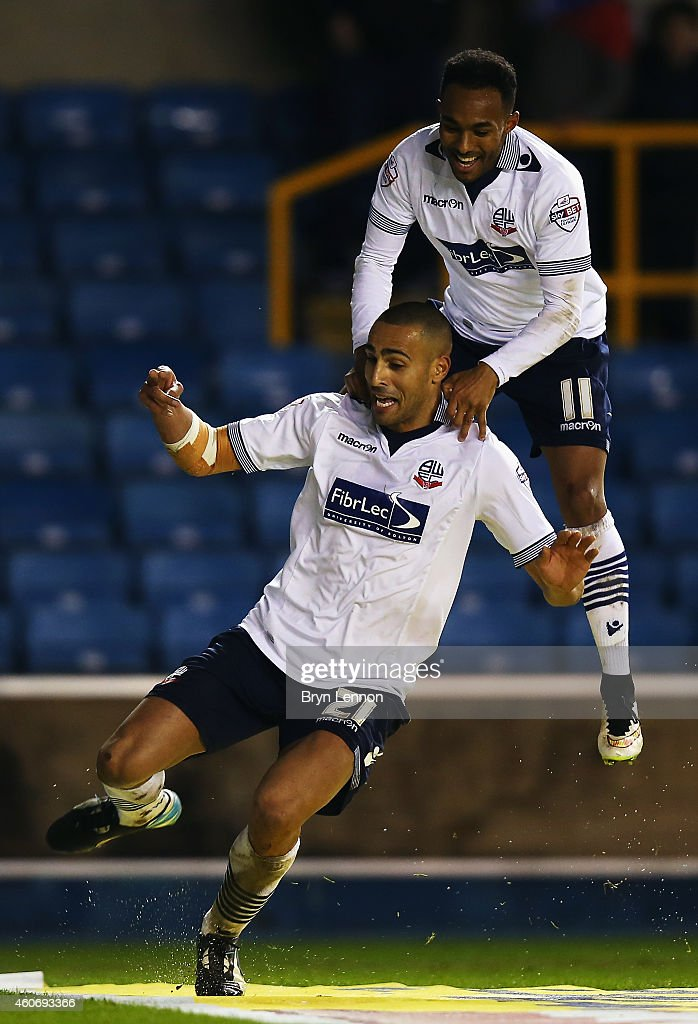 Darren Pratley of Bolton Wanderers celebrates scoring with team mate Rob Hall during the Sky Bet Championship match between Millwall and Bolton Wanderers at The Den on December 19, 2014 in London, England.