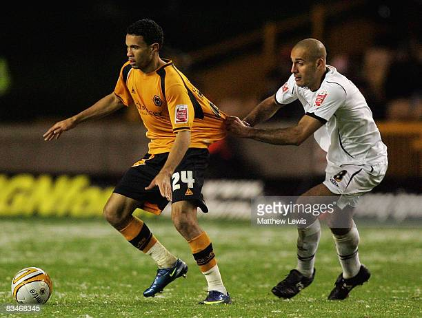 Darren Pratley of Swansea pulls the shirt of Carlos Edwards of Wolves during the CocaCola Championship match between Wolverhampton Wanderers and...