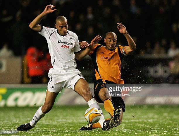 Darren Pratley of Swansea tackles Karl Henry of Wolves during the CocaCola Championship match between Wolverhampton Wanderers and Swansea City at...