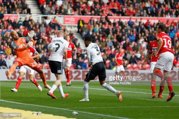 Darren Randolph of Middlesbrough punches the ball away from Oli McBurnie and Martin Olsson of Swansea City during the Sky Bet Championship match...