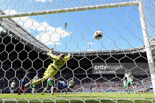 Darren Randolph of Republic of Ireland dives in vain as Antoine Griezmann of France scores his team's second goal during the UEFA EURO 2016 round of...