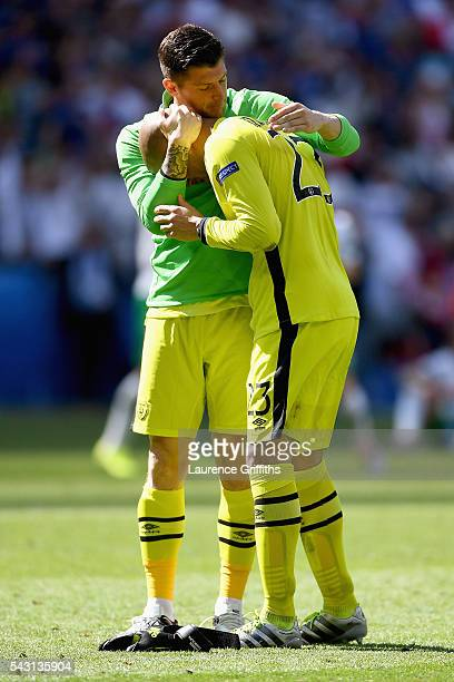 Darren Randolph of Republic of Ireland is consoled by Keiren Westwood after their team's 12 defeat in the UEFA EURO 2016 round of 16 match between...
