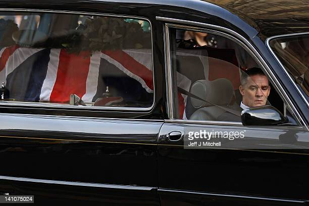 Darren Rathband the twin brother of PC David Rathband drives the hearse carrying his brother's coffin away from St Nicholas Cathedral on March 10...