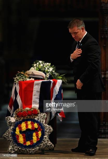 Darren Rathband the twin brother of PC David Rathband stands by his coffin during a memorial service inside St Nicholas Cathedral on March 10 2012 in...
