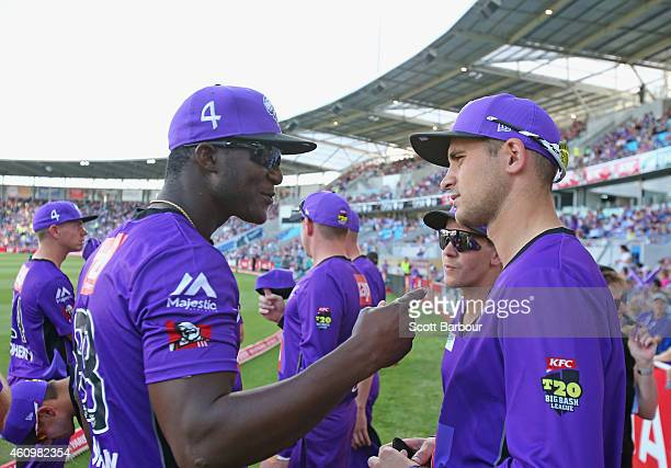 Darren Sammy and Alex Hales of the Hurricanes talk during the Big Bash League match between the Hobart Hurricanes and the Brisbane Heat at Blundstone...