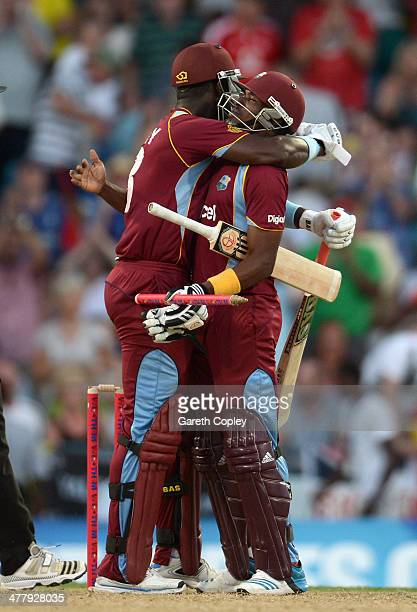 Darren Sammy and Dwayne Bravo of the West Indies celebrate winning the 2nd T20 International match between the West Indies and England at Kensington...