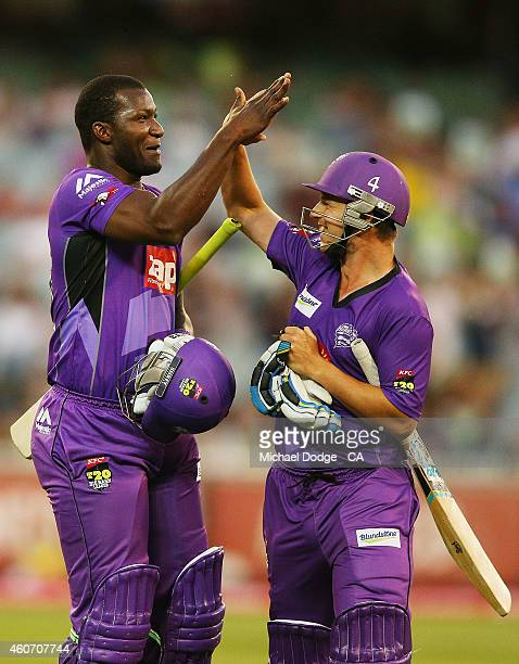 Darren Sammy and Evan Gulbis of the Hurricanes celebrate after their innings during the Big Bash League match between the Melbourne Stars and the...