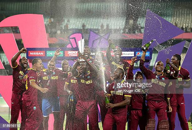 Darren Sammy, Captain of the West Indies and his team celebrate with the trophy during the ICC World Twenty20 India 2016 final match between England...