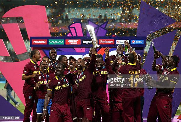Darren Sammy Captain of the West Indies and his team celebrate with the trophy during the ICC World Twenty20 India 2016 final match between England...