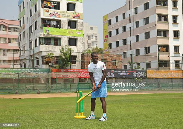 Darren Sammy captain of the West Indies bats as he plays a game of cricket with children during an ICC Thinkwise CSR event at the ShereBangla Mirpur...