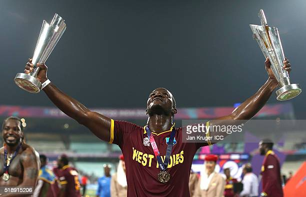 Darren Sammy, Captain of the West Indies celebrate with the trophy during the ICC World Twenty20 India 2016 final match between England and West...