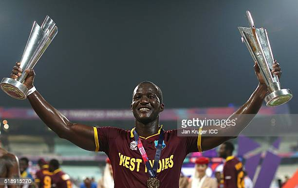 Darren Sammy Captain of the West Indies celebrate with the trophy during the ICC World Twenty20 India 2016 final match between England and West...