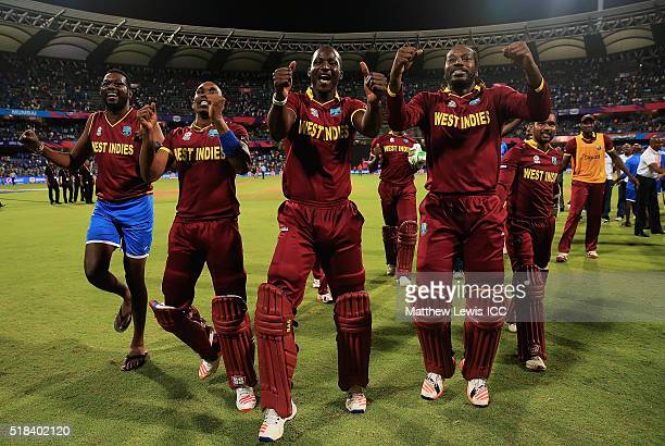 Darren Sammy Captain of the West Indies celebrates his teams win over India with Sulieman Benn Dwayne Bravo Chris Gayle during the ICC World Twenty20...