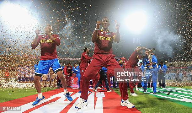 Darren Sammy Captain of the West Indies celebrates his teams win after defeating England with Dwayne Bravo of the West Indies during the ICC World...