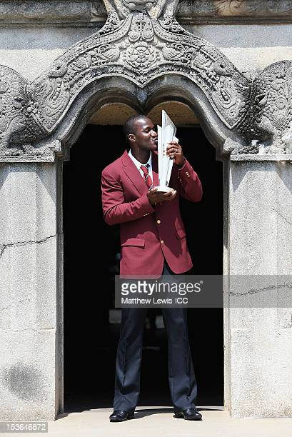 Darren Sammy captain of the West Indies Cricket team poses for a photograph with the ICC World T20 Trophy at Independence Square on October 8 2012 in...