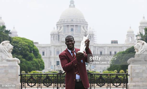 Darren Sammy Captain of the West Indies poses with the trophy during a photocall after winning the Final of the ICC Men's World Twenty20 on April 4...