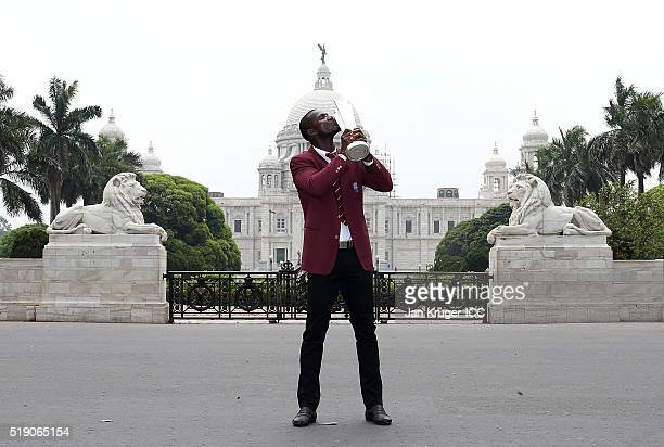 Darren Sammy Captain of the West Indies poses with the trophy during a photocall after winning the Final of the ICC Men's World Twenty20 at the...