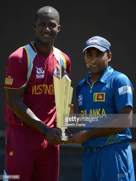 Darren Sammy, captain of West Indies, Mahela Jayawardene, captain of Sri Lanka pose with the ICC World T20 trophy ahead of the 2012 ICC World...