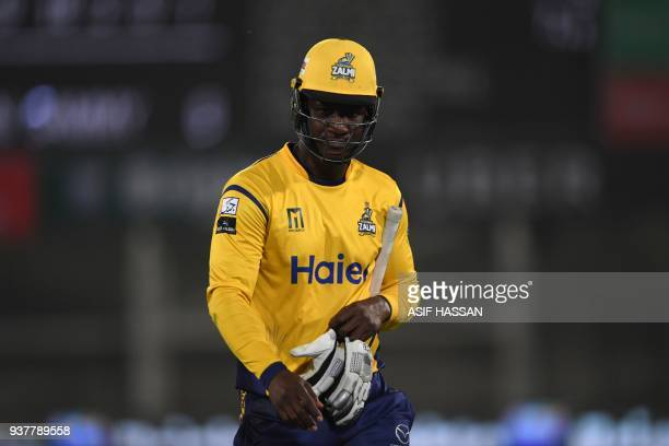 Darren Sammy of Peshawar Zalmi walks back to the pavilion after his dismissal by Shadab Khan of Islamabad United during the Pakistan Super League...