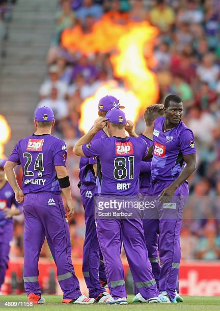 Darren Sammy of the Hurricanes celebrates with his teammates after bowling Jimmy Peirson of the Heat during the Big Bash League match between the...