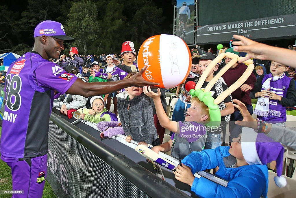 Darren Sammy of the Hurricanes gives a signed beachball to a young supporter in the crowd after the Big Bash League match between Hobart Hurricanes and Brisbane Heat at Blundstone Arena on December 22, 2015 in Hobart, Australia.